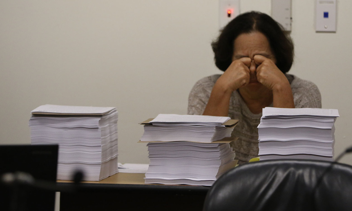 A legislative assistant faces more than 4,000 pages of testimony on bills to restrict aquarium fishing during a hearing of the House Committee on Ocean, Marine Resources and Hawaiian Affairs.