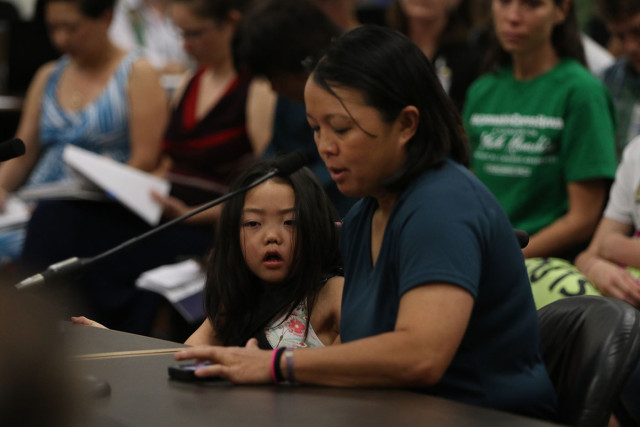 6-year-old Maile Kaneshiro sits as mom Jari Sugano as she testifies in support of House BIll 321.  7 feb 2015. photograph by Cory Lum/Civil Beat
