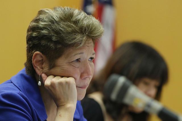 Councilwoman Carol Fukunaga listens to testimony during hearing on Hoopili development. 5 march 2015. photograph Cory Lum