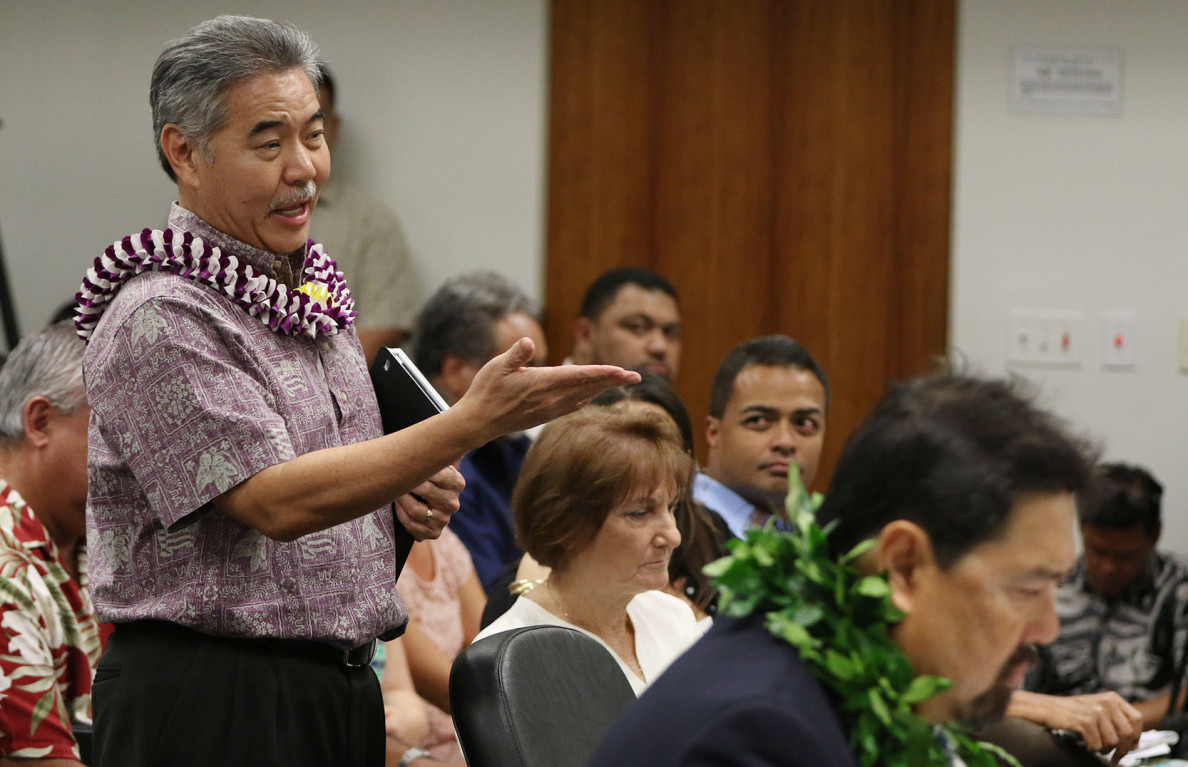 Governor Ige rises to answer questions from Chair Committee on Water and Land Laura Thielen early in second day of confirmation hearing. 12 march 2015. photograph Cory Lum/Civil Beat