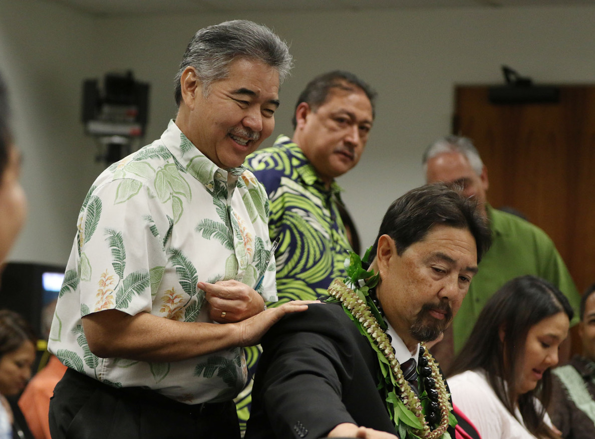 Gov. David Ige, left, encourages his DLNR nominee, Carleton Ching, before the confirmation hearing. Environmentalists say that as a pro-development lobbyist, Ching is unqualified to head a department charged with protecting public lands. The committee ultimately voted 5-2 to opposed the nomination.