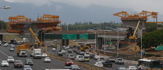 Construction progresses on cantilevered supports going across near the H1/H2 merge looking westbound.  19 march 2015. photograph Cory Lum/Civil Beat