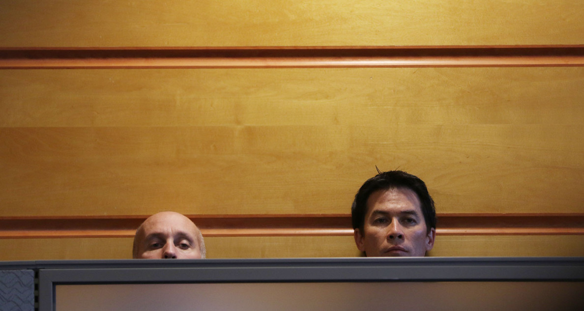 People peeped over office barriers as the bids were announced. Once again, those bids came in high.
