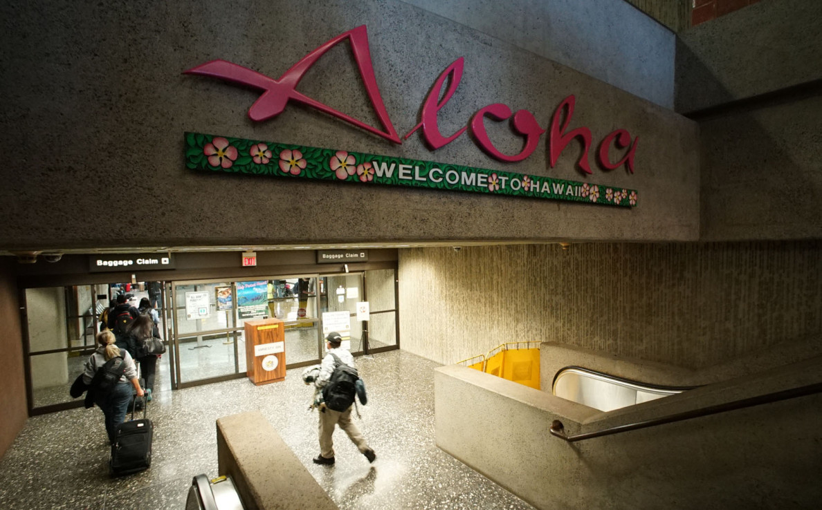 Travelers navigate signs in the Honolulu International Airport. Honolulu, Hawaii 27 feb 2015. photograph Cory Lum/Civil Beat