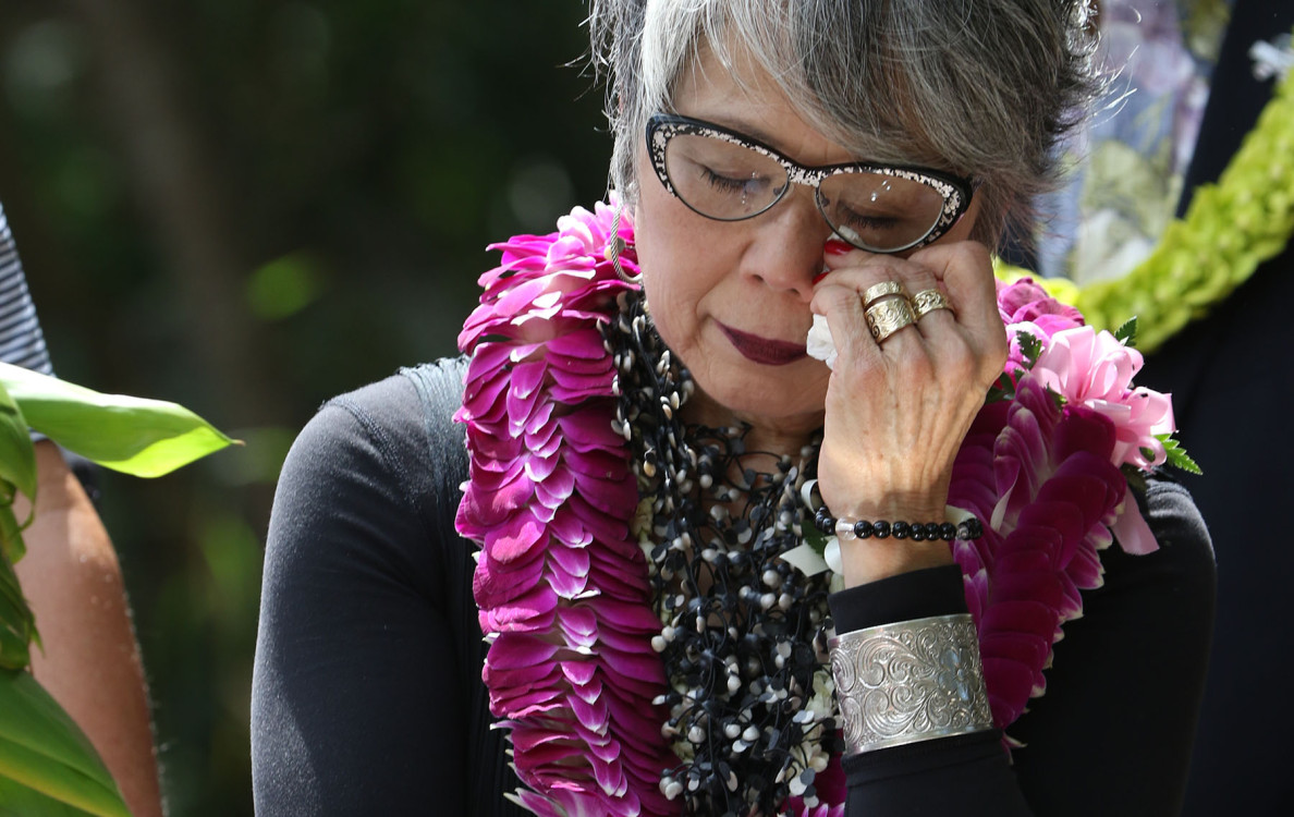 Carole Hayashino, president and executive director of the Japanese Cultural Center of Hawaii during a somber moment at the dedication ceremony.
