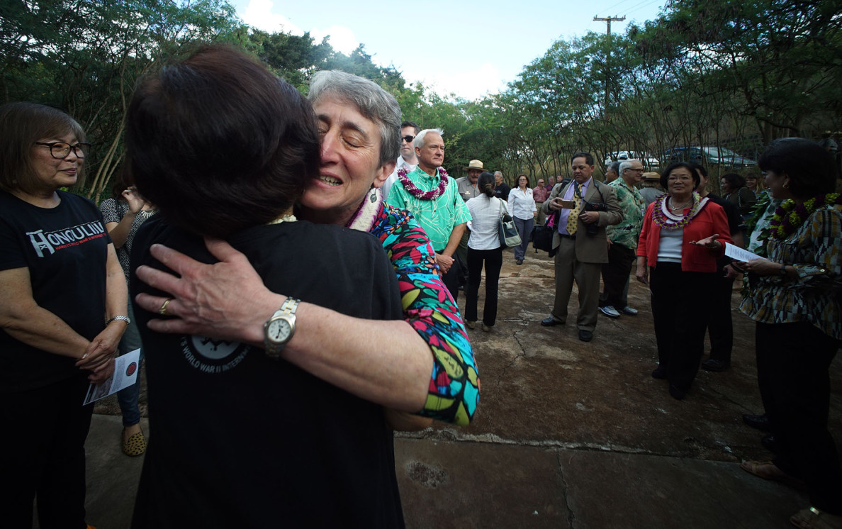 U.S. Secretary of the Interior Sally Jewell hugs a volunteer before the dedication ceremony. Jewell implored people to remember the past so we don't repeat the mistakes in the future.