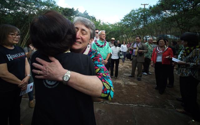 U.S. Secretary of the Interior Sally Jewell hugs a volunteer before Honouliuli Monument dedication ceremony.  31 march 2015. photograph Cory Lum/Civil Beat