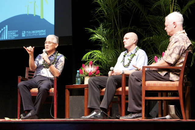 Hawaiian Electric Co. President Alan Oshima, left, talks about energy issues as NextEra Energy Hawaii President Eric Gleason listens, Wednesday, on the first day of the Maui Energy Conference.
