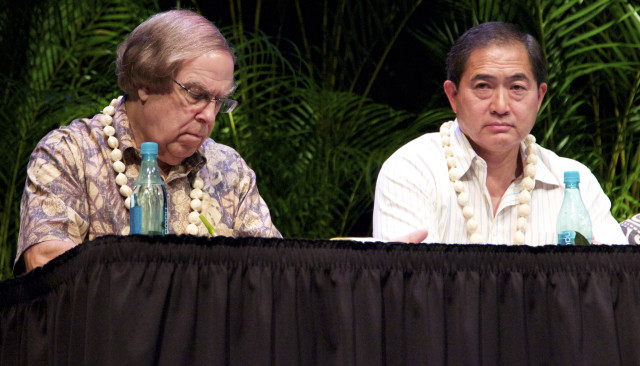 Hawaii Consumer Advocate Jeff Ono, right, and Thomas Gorak, chief counsel at Hawaii Public Utilities Commission, listen during a panel discussion at the Maui Energy Conference, Thursday.