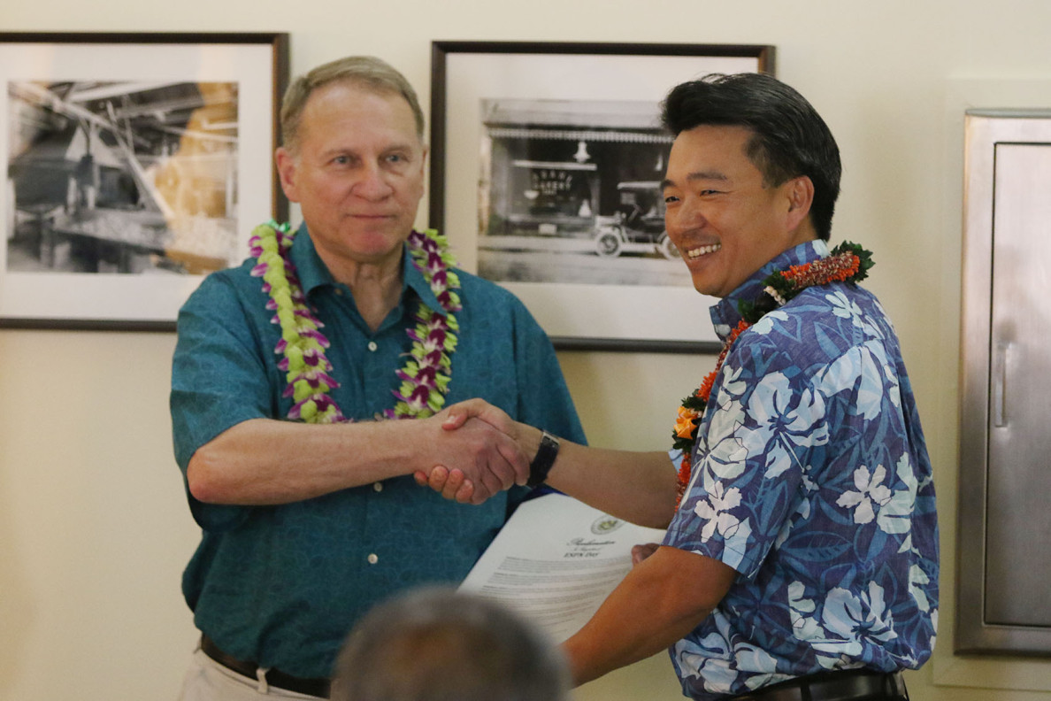 Hawaii Lt. Gov. Shan Tsutsui honored ESPN sportscasters Kanoa Leahy and Neil Everett at a ceremony at the Hawaii State Art Museum this week. Here, he gives a proclamation to Pete Derzis, senior vice president of ESPN Events.
