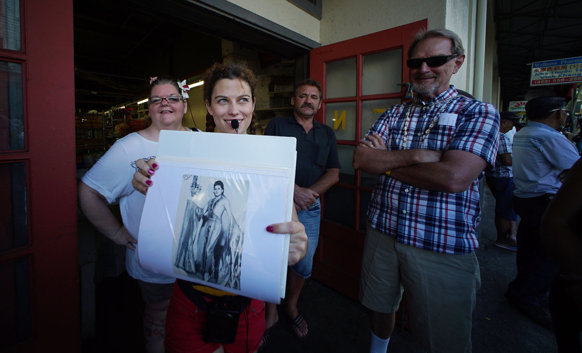 Carter Churchfield holds a photograph of 'Hanalei' a transvestite show featured along Hotel Street.  25 march 2015. photograph Cory Lum/Civil Beat