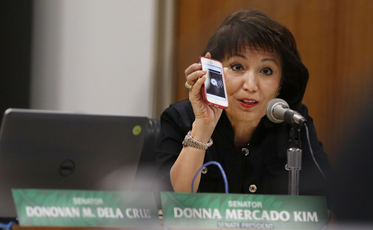 Senate President Donna Mercado Kim held up her cell phone and claimed to have a recording of Mayor Caldwell previously saying he wouldn't be coming back to the Legislature to ask for more rail money.