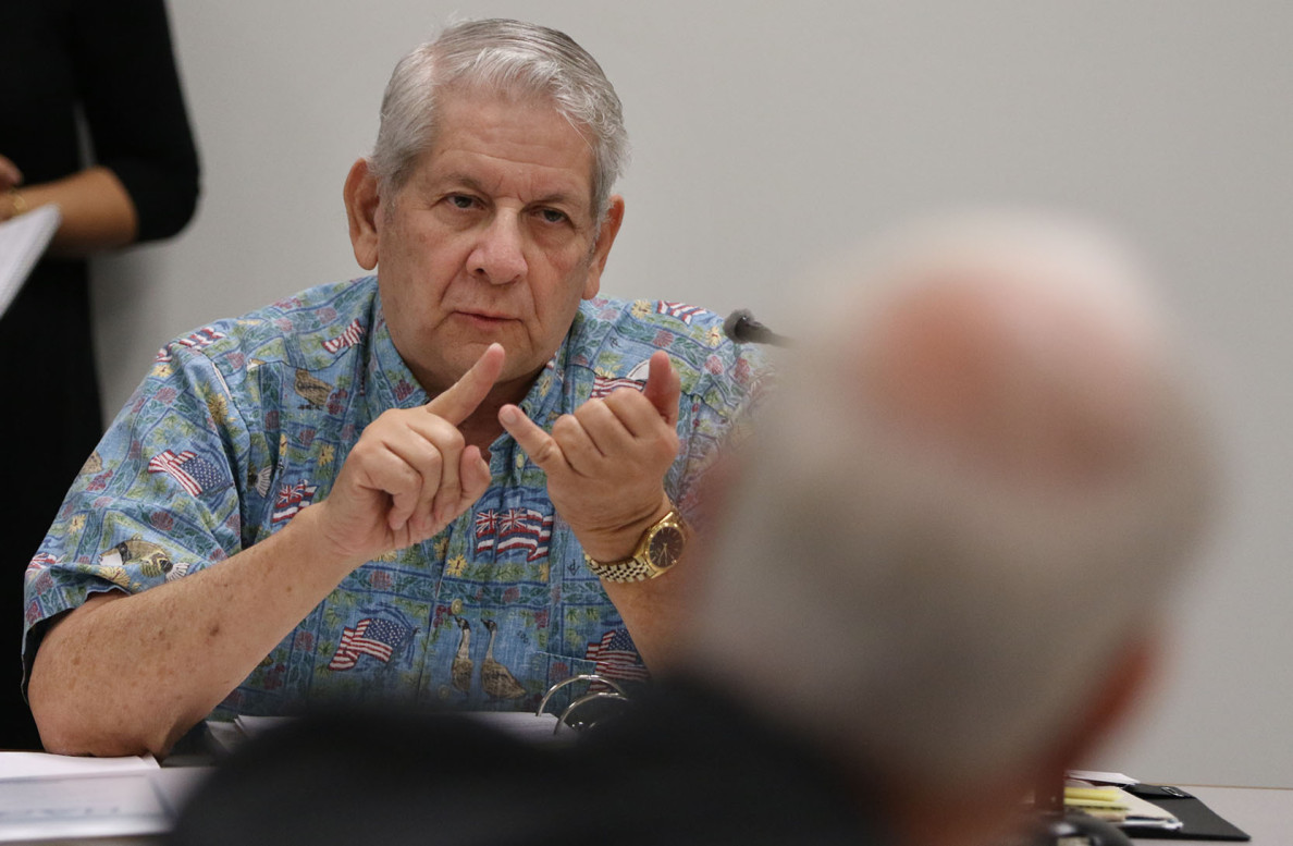 Sen. Sam Slom grilled Honolulu Mayor Kirk Caldwell during a hearing Wednesday on the city proposal to extend a General Excise Tax surcharge indefinitely to pay for the over-budget rail construction project.