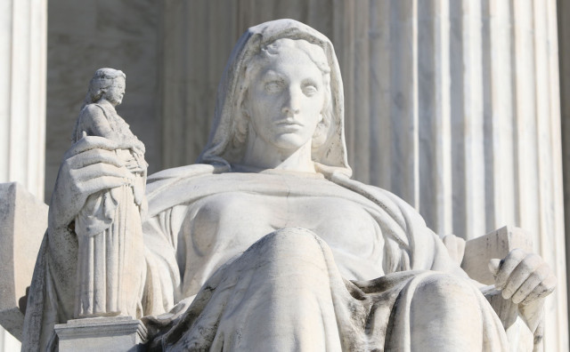 Carved statues on the front of the Supreme Court Building. Washington DC. 23 feb 2015. photograph Cory Lum/Civil Beat
