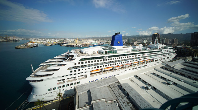 Cruise ship docked next to Aloha Tower.  24 march 2015. photograph Cory Lum/Civil Beat