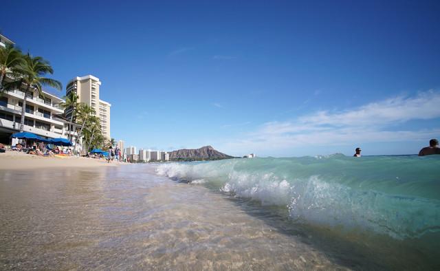 Small waves thrash the beach and sand in Waikiki. Honolulu. Hawaii. 2 march 2015. photograph cory Lum/Civil Beat