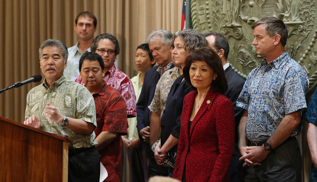 Governor David Ige leads lawmakers into his office to announce the Kawela Bay acquisition.  30 april 2015. photograph by Cory Lum/Civil Beat