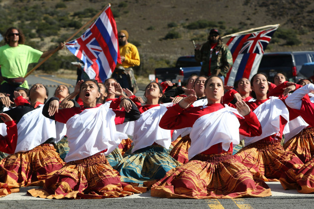 Women from Halau Na Lei Kaumaka O Uka under the direction of Kumu Hula Napua Greig from Maui dance and chant at the Mauna Kea visitor's center. 10 april 2015. photograph by Cory Lum/Civil Beat