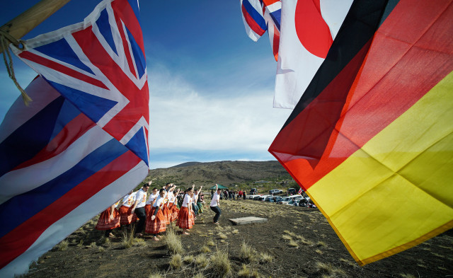 Women from Halau Hi'iakainamakalehua under the direction of Kumu Hula Lono Padilla and Keano Kaupu at the Mauna Kea visitor's center. 10 april 2015. photograph by Cory Lum/Civil Beat