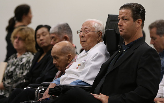 Jonathan Hanks, front right, sits next to left, Noboru Kawamoto, a private-pay resident at his community care family foster home in Kaneohe. 13 feb 2015.  .photograph Cory Lum/Civil Beat