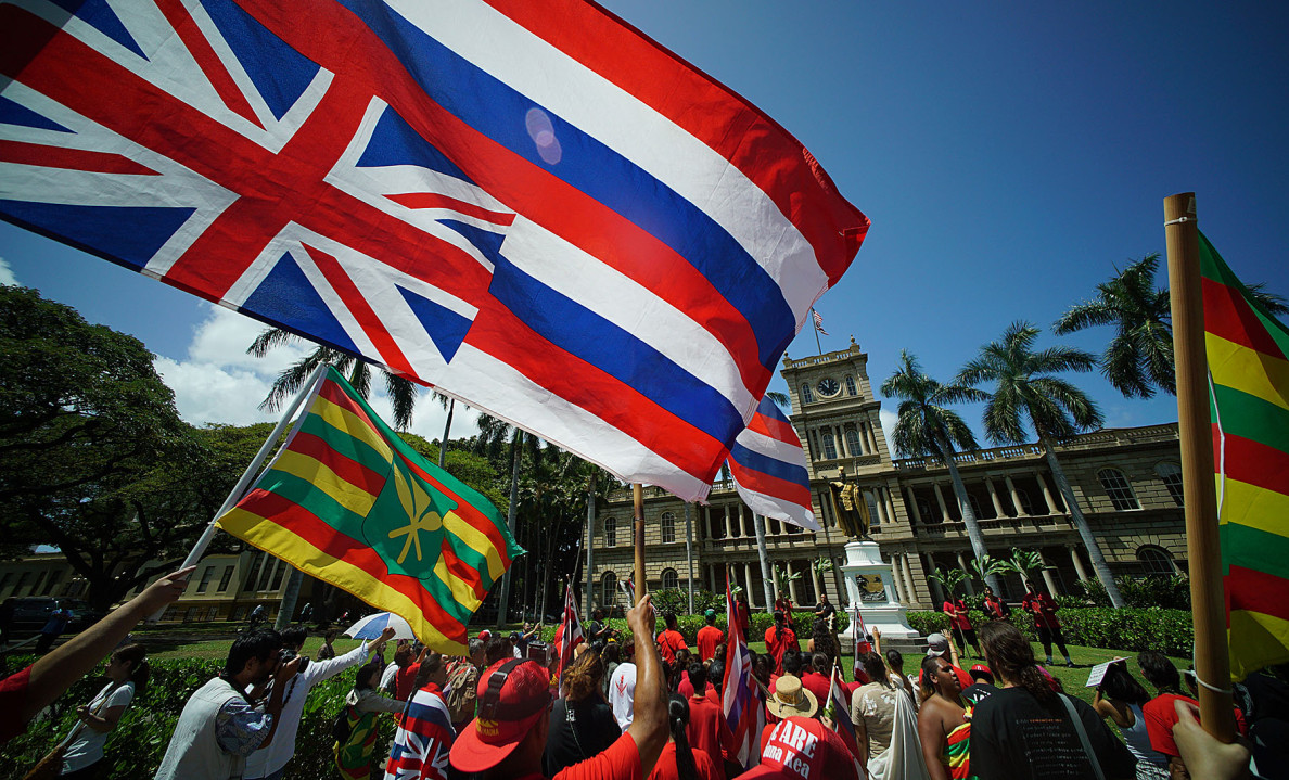 Demonstrators gather at he KIng Kamehameha statue on their way to the Governor's office. 21 april 2015. photograph Cory Lum/Civil Beat