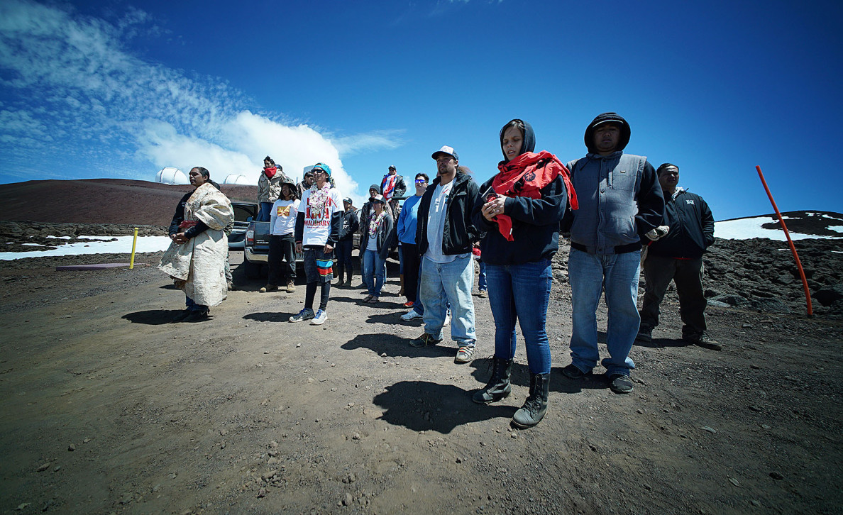 Demonstrators gather after walking to the TMT construction site near the summit of Mauna Kea last Saturday. Native Hawaiians consider the mountaintop sacred.