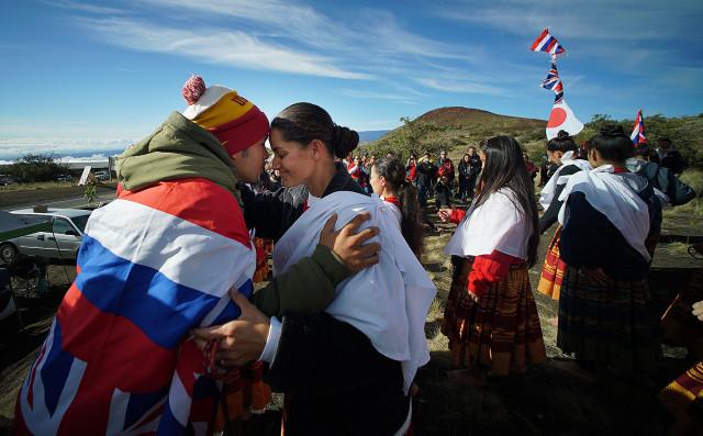 Hula Halau from the outer islands join demonstrators near the Mauna Kea visitors center on Mauna Kea.. 11 april 2015. photograph Cory Lum/Civil Beat