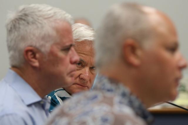 Mayor Kirk Caldwell looks on as Senate Ways and Means chair Jill Tokuda questions HART Chair Dan Grabauskas. 7 april 2015. photograph by Cory Lum/Civil Beat
