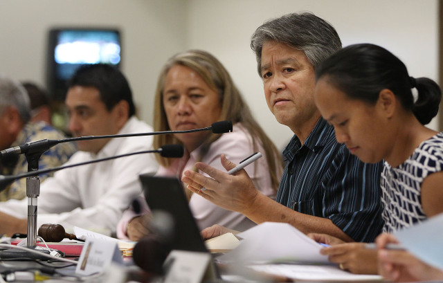 Representative Roy Takumi is flanked by Representative Belatti during joint House/Senate education committee meeting. 22 april 2015. photograph by Cory Lum/Civil Beat