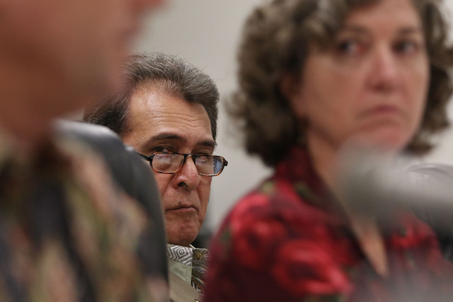 Senator Brickwood Galuteria is framed by Chair Laura Thielen during Senate recommendation hearing on land use and water commission.  15 april 2015. photograph by Cory Lum/Civil Beat