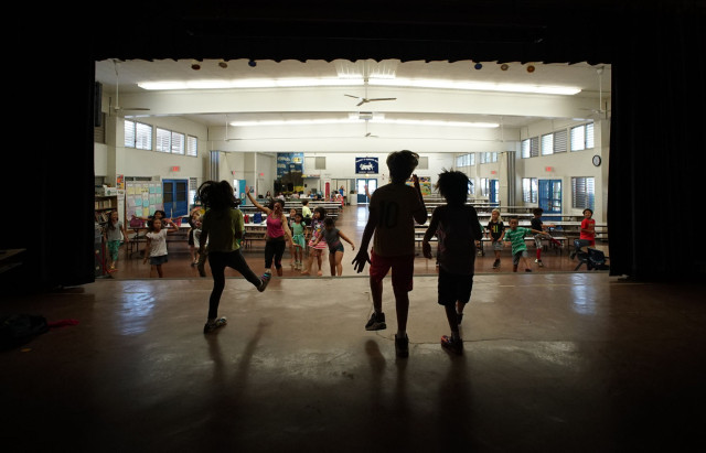 Catherine Caine Waikiki Elementary School Teacher and 2015 Hawaii Teacher of the Year  dances in zumba class held in the school's cafeteria.  2 apr 2015. photograph Cory Lum/Civil Beat