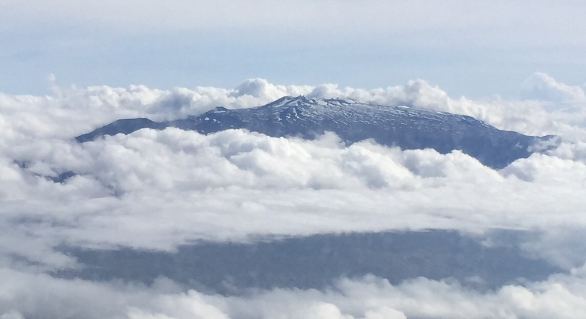 It takes an airplane window vantage point to look down on the Big Island's Mauna Kea, the highest point in Hawaii at an elevation of 13,796 feet.