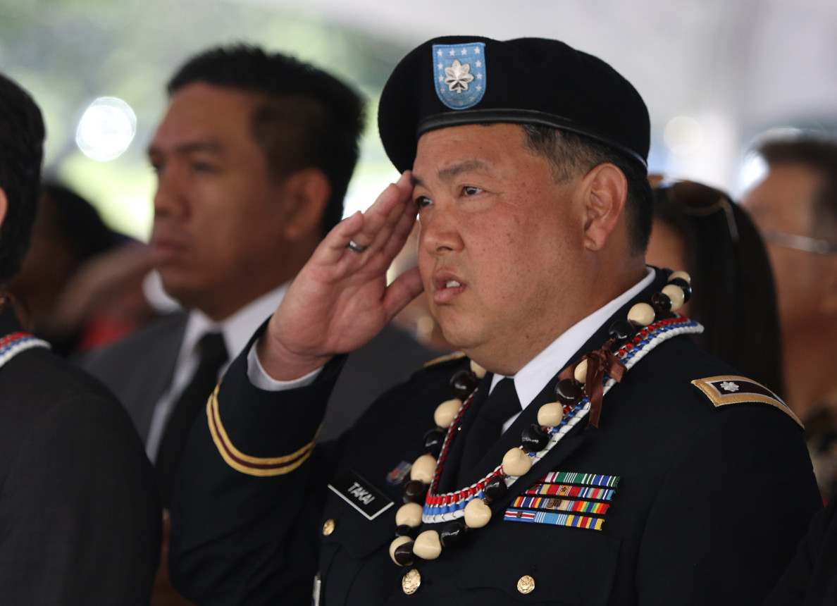 U.S. Rep. Mark Takai, a combat veteran and lieutenant colonel in the Hawaii Army National Guard, salutes during the Memorial Day ceremony.