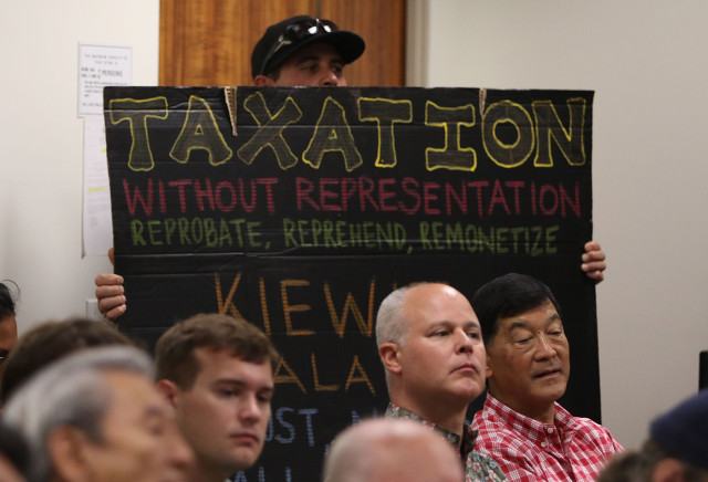 John Correa holds his sign during joint senate/house meeting regarding GET/rail. 1 may 2015. photograph by Cory Lum/Civil Beat