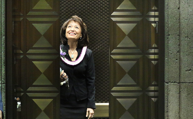Outgoing Sen President Donna Mercado Kim smiles and rides the private elevator after being ousted as senate president.  5 may 2015. photograph Cory Lum/Civil Beat