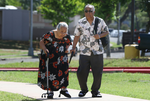 People head to day activities at the Kuhio Park Terrace Family Center.12 may 2015. photograph Cory Lum/Civil Beat