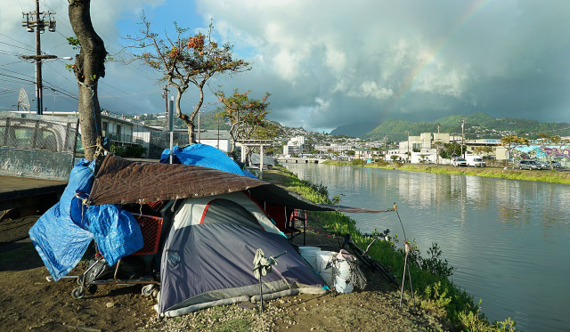 Tents and other belongings along the banks of the Kapalama Canal. 19 may 2015. photograph Cory Lum/Civil Beat