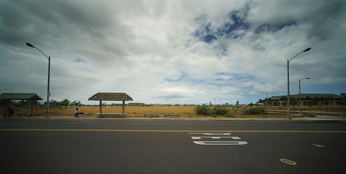 Single person waits at bus stop on Haumea Street, Kapolei fronting empty parcels of property in Kapolei. 20 may 2015. photograph Cory Lum/Civil Beat