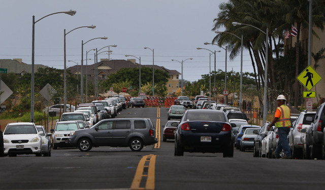 Packed parking along UluOhia Street leaded towards Kapolei Hale. Kapolei. 20 may 2015. photograph by Cory Lum/Civil Beat