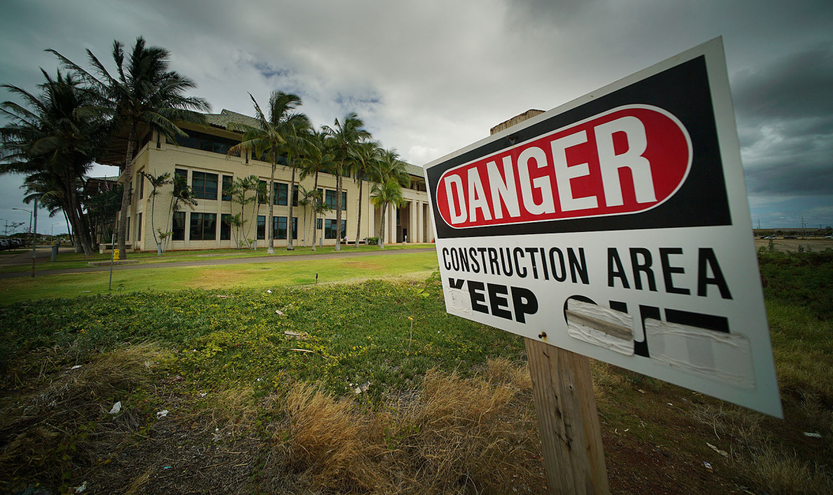 Danger sign on adjacent empty parcel with Kapolei Hale at left. Kapolei. 20 may 2015. photograph Cory Lum/Civil Beat