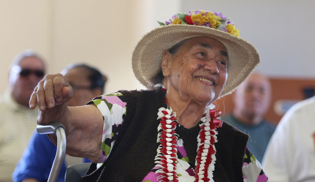 Reverend Fesilafai Malae leads a prayer song before senior dance class held at the Kuhio Park Terrace 12 may 2015. photograph Cory Lum/Civil Beat