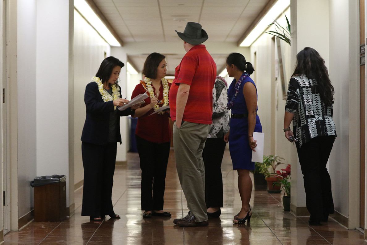 During conference committee negotiations, Rep Sylvia Luke, left, Sen Jill Tokuda and Rep. Della Au Belatti compare notes outside the meeting room.