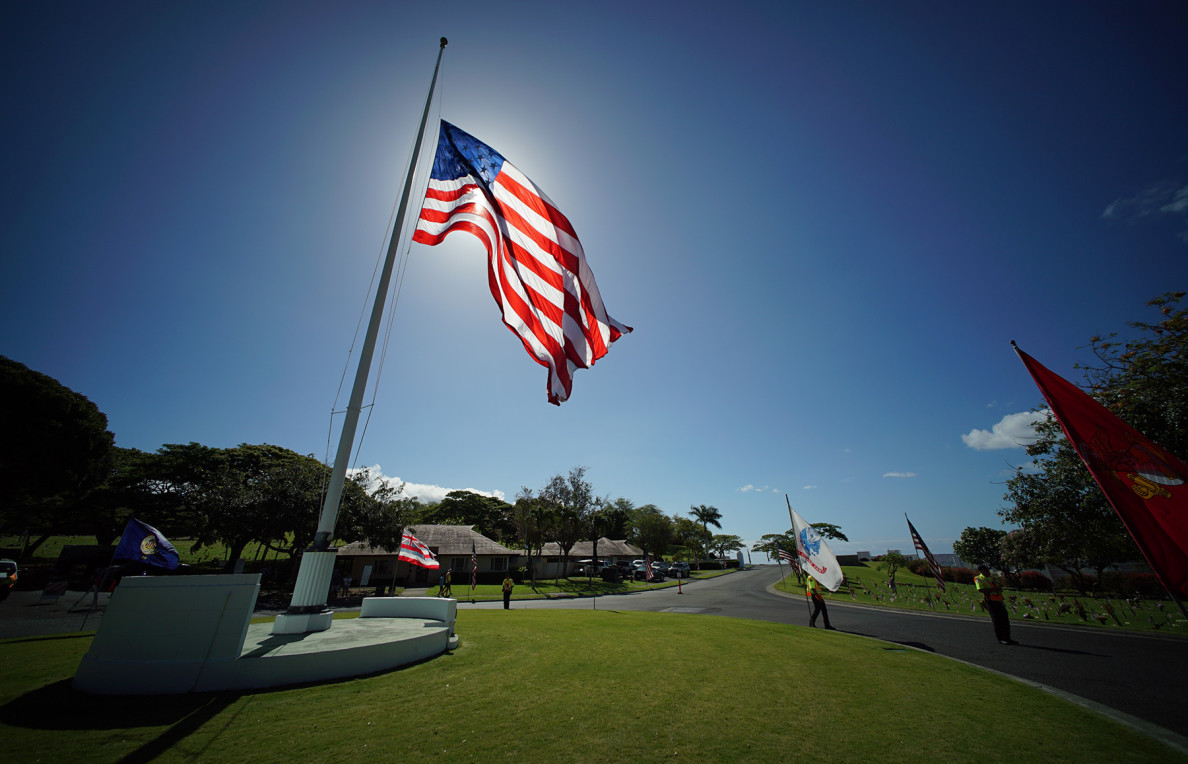 Flags fly at the National Memorial Cemetery of the Pacific before the city of Honolulu's 66th annual Memorial Day service Monday.