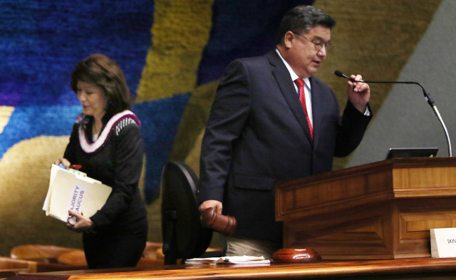 Outgoing Senate President Mercado Kim walks away after giving the gavel to new Senate President Donald Kouchi. 5 may 2015. photograph Cory Lum/Civil Beat