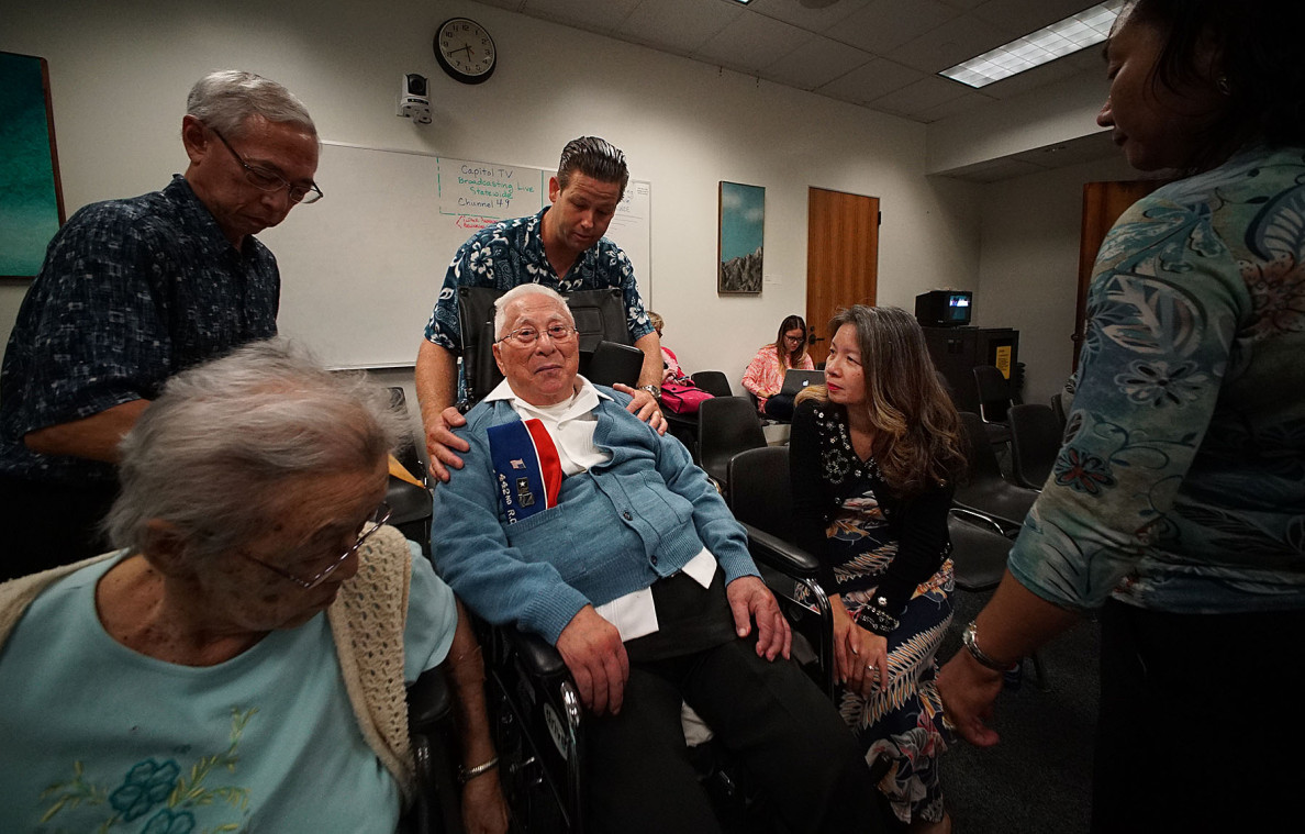 Sen. Suzanne Chun Oakland consoles Noboru Kawamoto, 94, after a bill that supporters said would have allowed him to live with his wife in a care home was rejected over concerns that it would displace Medicaid patients.