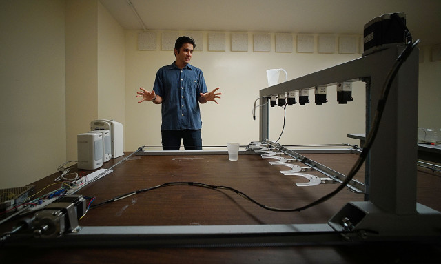Professor Mora describes this robot he built. 13 may 2015. photograph Cory Lum/Civil Beat
