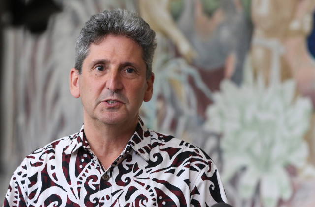University of Hawaii President David Lassner gives a press conference in response to Governor Ige's 10 points about TMT/Mauna Kea fronting Jean Charlot's fresco at Bachman Hall. UH Manoa. 26 may 2015. photograph Cory Lum/Civil Beat