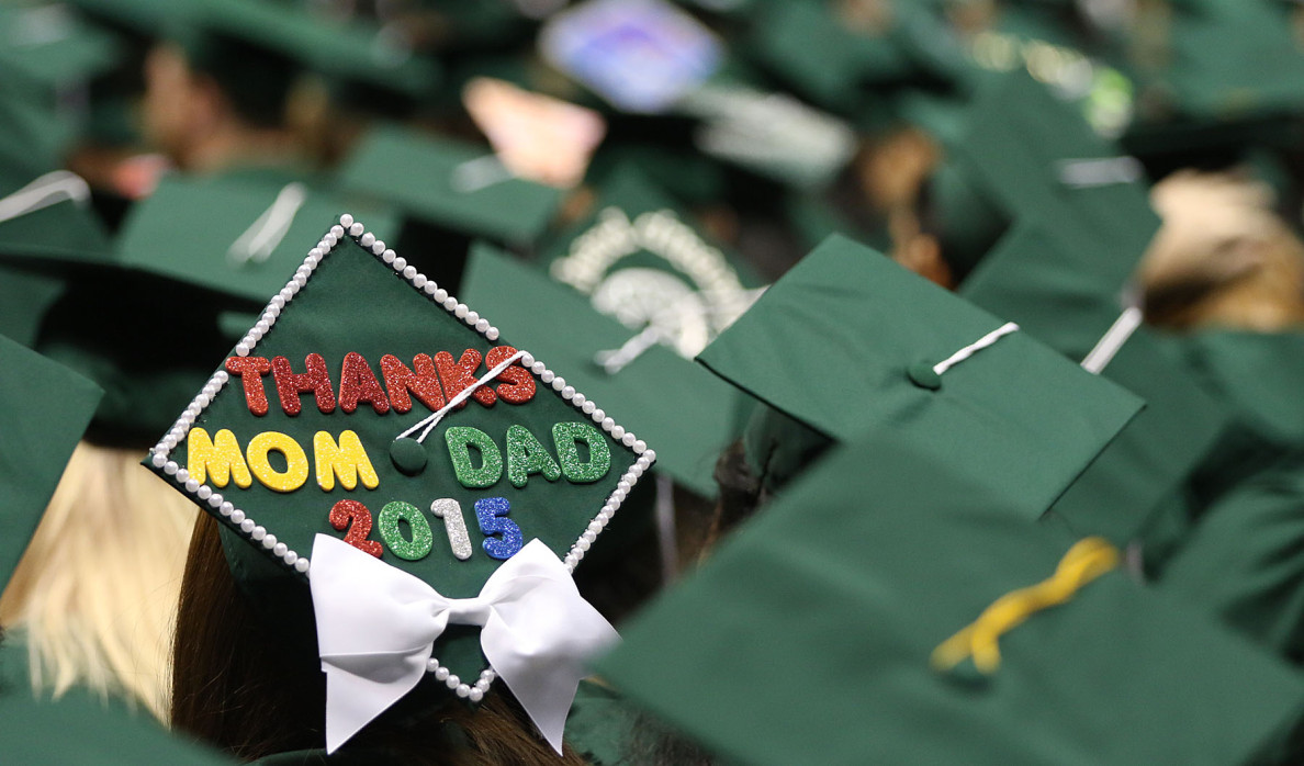 No doubt representing the feelings of many of the graduates, a senior shows off a message of thanks to her parents.