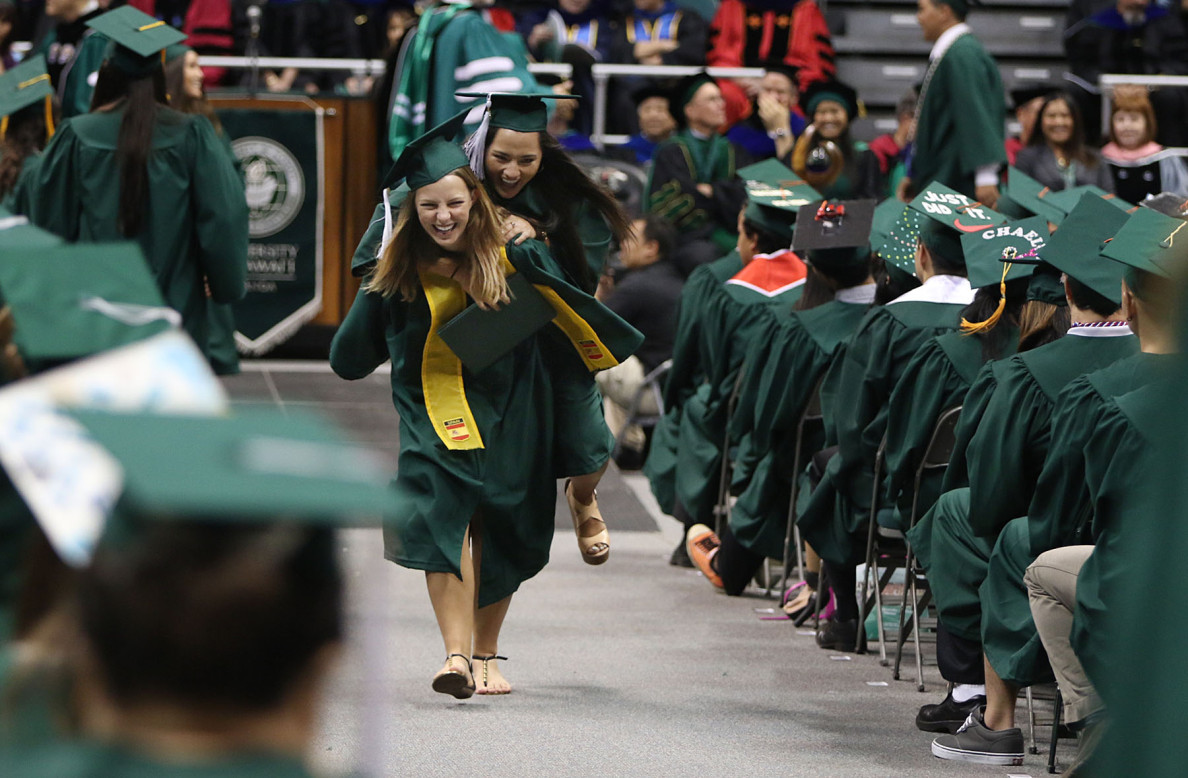 A diploma becomes a ticket to ride  for Noelle Pahk, who gets a lift from Madison Pickard after they received their degrees.