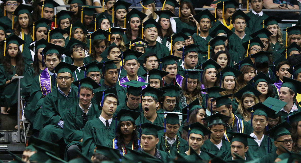 The students display a range of reactions during the commencement ceremony.